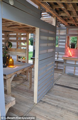 The homes are constructed out of the 150 million pallets that end up in landfills in the U.S. each year
