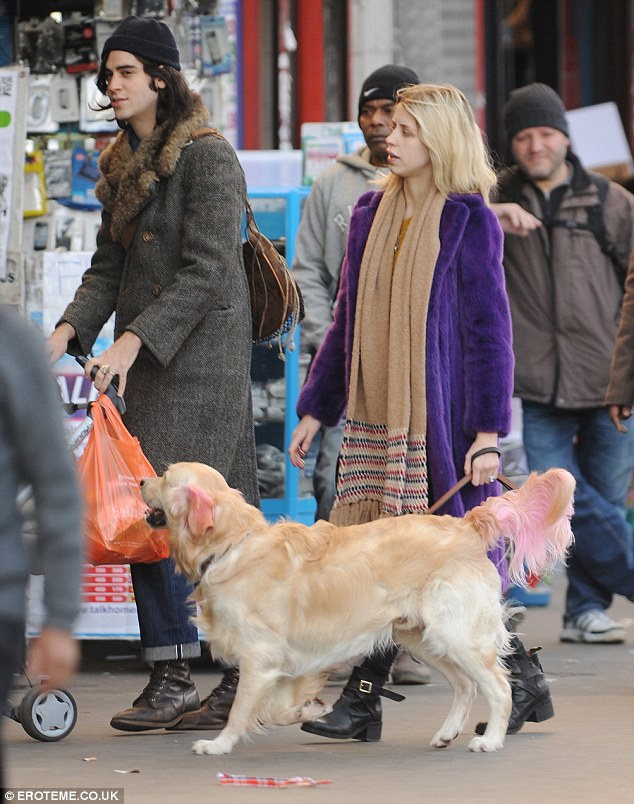Eye-catcher: The 23-year-old made sure all eyes were on her as she donned a bright purple coat during the casual stroll