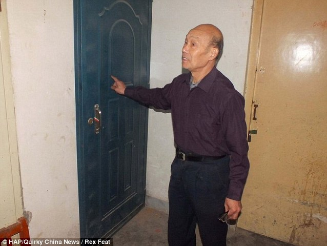 A resident shows the door leading to Li Hao's tiny cellar. Hao has been convicted on charges including murder, rape, organized prostitution and illegal detention