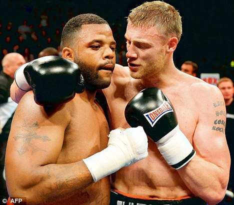 Over and out: Flintoff consoles his opponent Dawson after beating him in Manchester