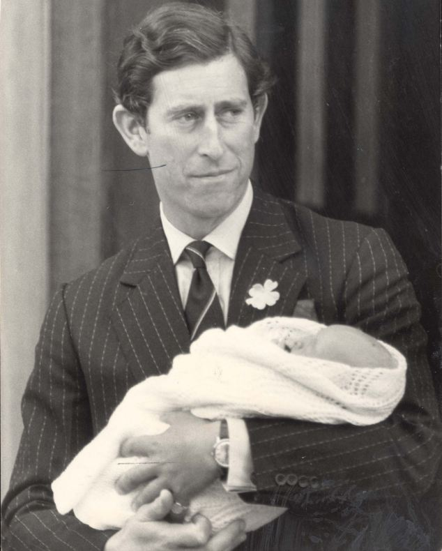 Prince Charles leaving St. Mary's Hospital in Paddington, London, with his baby son William