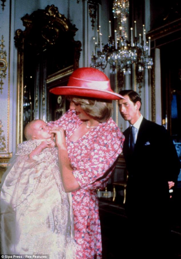 Worlds apart: Charles and Diana with William at Buckingham Palace at William's christening in 1982