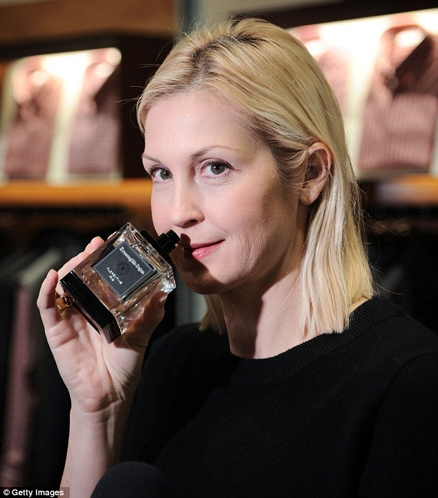 Smell of success: Kelly Rutherford gets in some early Christmas shopping