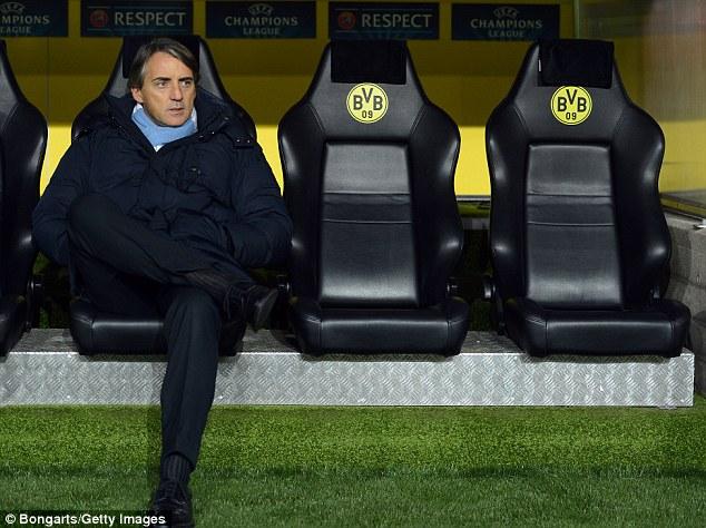 Ready to go: City boss Roberto Mancini takes his seat in the dugout prior to the Dortmund clash