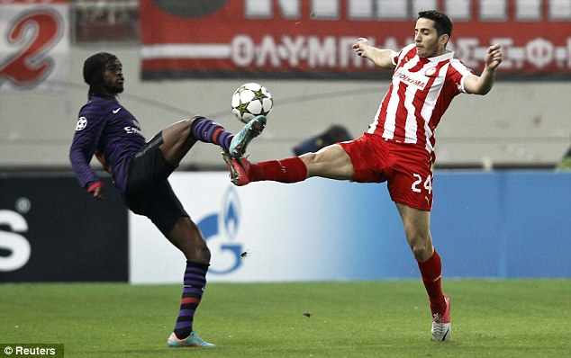 Stalemate: Arsenal's Gervinho (left) and Olympiacos' Kostas Manolas compete for the ball