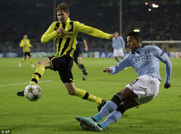 Feeding off scraps: Scott Sinclair (right) attempts a cross for Manchester City