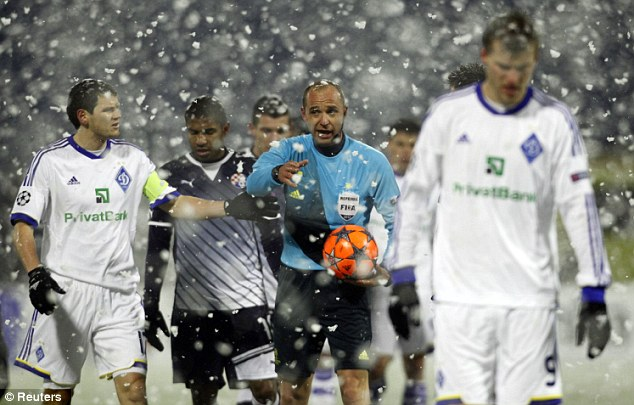 Delay in play: Referee Stanislav Todorov suspends play for 10 minutes between Dinamo Zagreb and Dynamo Kiev after pitch markings were covered by heavy snow