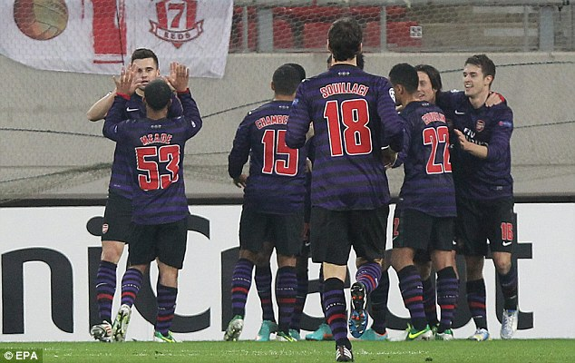 Gunning for top spot: Arsenal players celebrate after Tomas Rosicky's (second right) strike before half-time