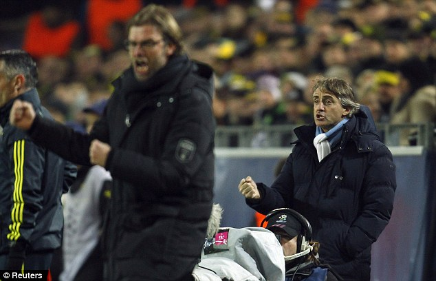More to come: Roberto Mancini's (right) Manchester City team struggled to create first half chances
