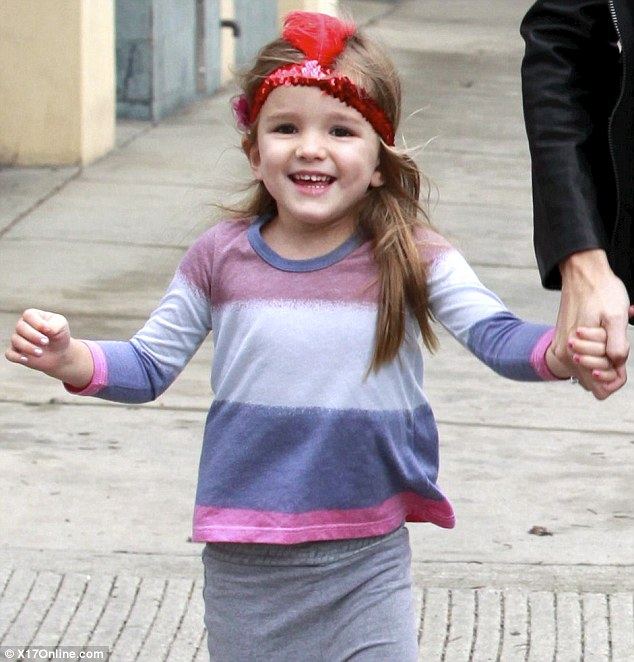 Having a ball: The youngster was in great spirits, sporting a big smile and wearing a cute feathered headband