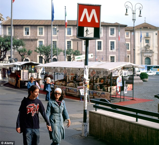 The real Rome Metro: A couple walks past the Piazza della Republica metro station in Rome, Italy