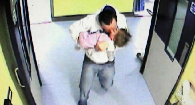 Guilty: McCarney, pictured with his 15-month-old victim in his arms, was found guilty of her murder by a unanimous verdict