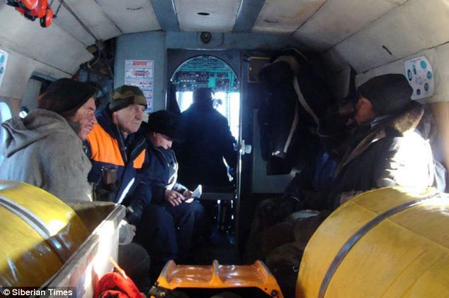 Dramatic survival: The pair, who survived for three months, in their rescue helicopter in November