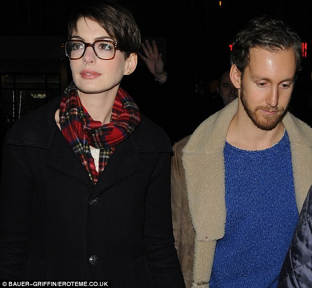 Anne Hathaway Sports Fetching Glasses As She Joins Co-star