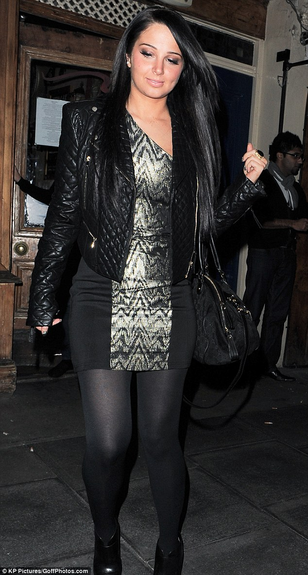Consoling herself: Tulisa headed out to dinner with a group of pals on Tuesday night following the disappointing performance of her debut solo album in the midweek charts