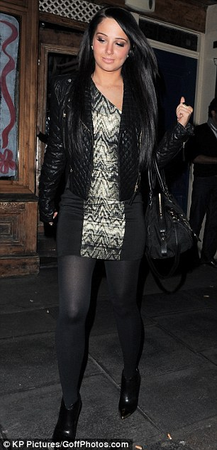 Reflecting her mood? Tulisa stepped out in an all-black ensemble after hearing her dismal mid-week chart performance