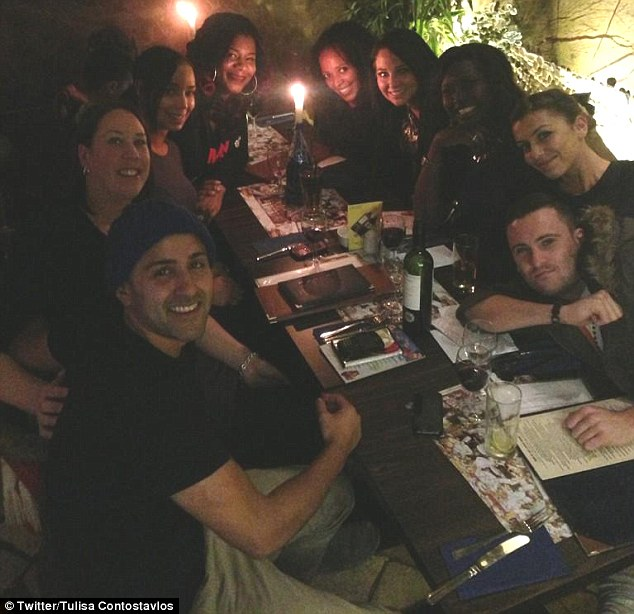 Keeping her spirits up: Tulisa celebrated a friend's birthday with a large group of pals