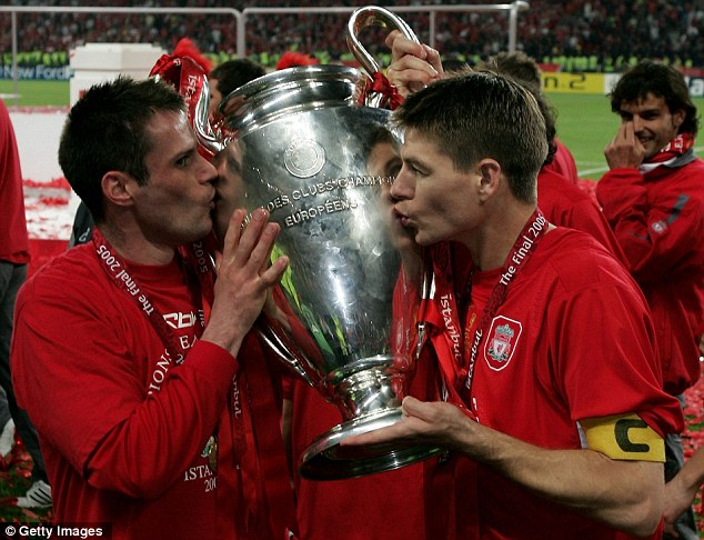 Sealed with a kiss: Jamie Carragher celebrates Liverpool's 2005 Champions league success with Steven Gerrard in Istanbul