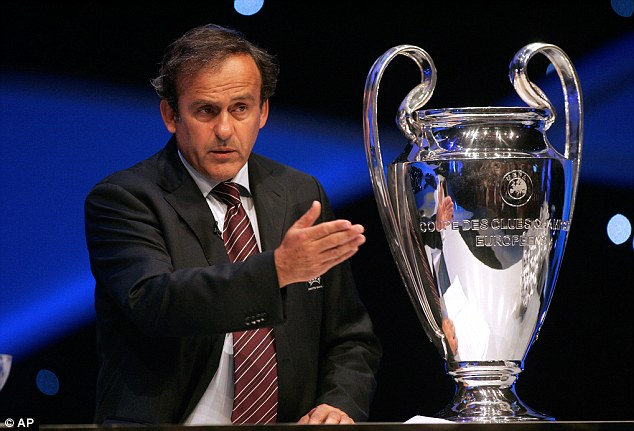 Over to you: Jamie Carragher believes UEFA president Michel Platini should change the format of the Champions League