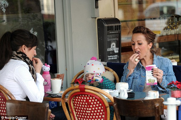 Healthy and happy: Former Eastenders star Natalie Cassidy looked a picture of health with daughter Eliza in Islington on Monday afternoon