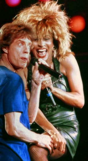 Music star Tina Turner (pictured with Mick Jagger) at the height of her 1980s fame