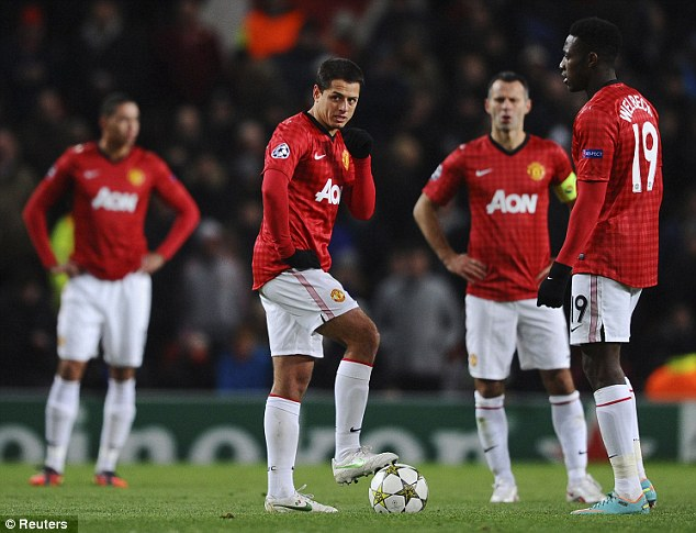 Shocked: Javier Hernandez, Ryan Giggs and Danny Welbeck react after Cluj take the lead