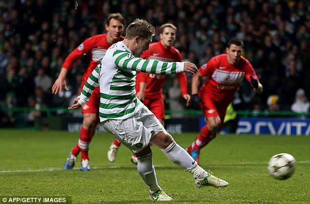 Spot on: Kris Commons rifles home a penalty to secure Celtic's place in the knockout stages