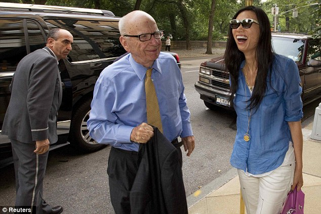 By his side: The Murdochs, pictured in New York last year, married in 1999 after his divorce from ex-wife Anna Maria Torv Murdoch Mann