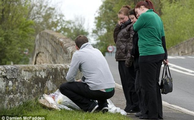 Support: Residents left floral tributes and cards to pay their respects at the time of the deaths