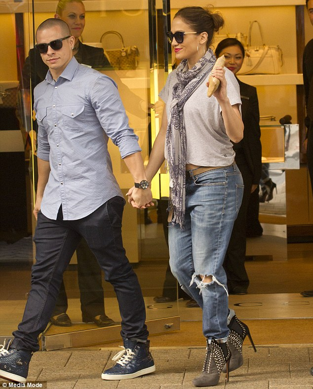 Retail therapy: Jennifer and Casper held hands as the left the Gucci store in Perth after it was closed for them to shop for almost an hour