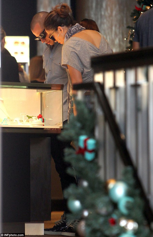 The ring's the thing: Jennifer Lopez and Casper Smart were seen browsing diamond rings at a Tiffany & Co. store in Perth on Thursday