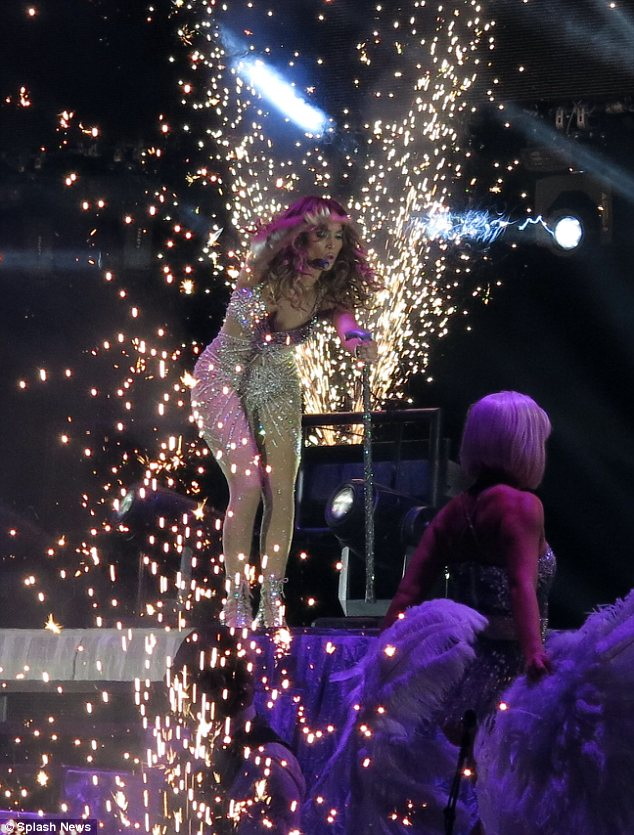 Out with a bang: The performance was littered with sequins and fireworks as the star cavorted about the stage