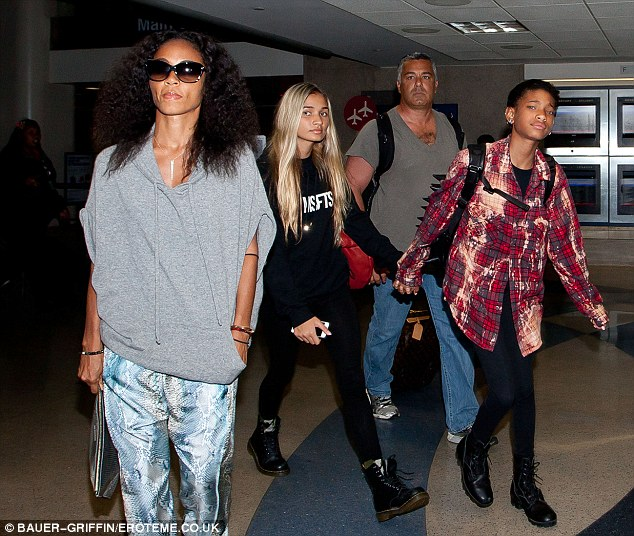 Super stylish family: Willow and Jaden Smith are accompanied by their mother Jada Pinkett-Smith as they arrive in LA from Kauai
