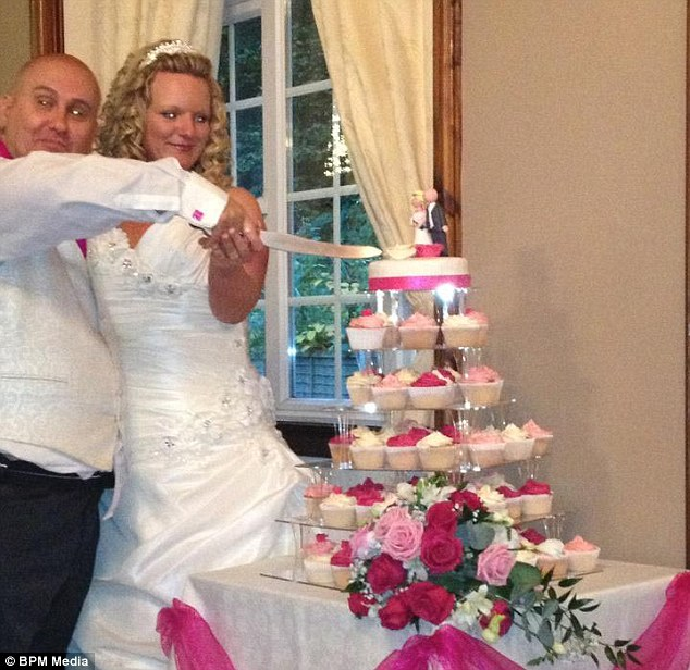 Shocking: A joyful Andrew and Claire Phillips cut their £175 wedding cake - blissfully unaware that an old schoolfriend would take it home and give it to her policeman boyfriend