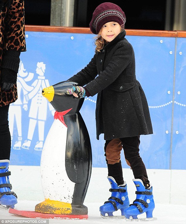 Cutie: Honor looked absolutely adorable as she maneuvered her way around the ice with the assistance of a penguin