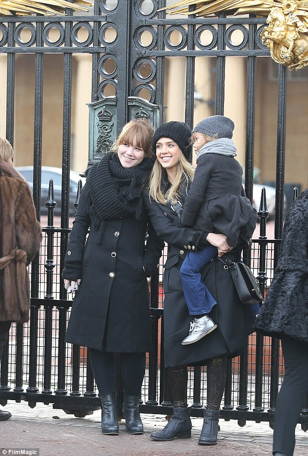 Capturing the memories: The mother-daughter duo posed for a series of snaps outside the gates to Buckingham Palace