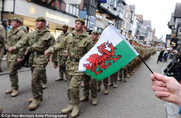 Proud: Soldiers from 1st Battalion marched through Chester before being awarded the medals