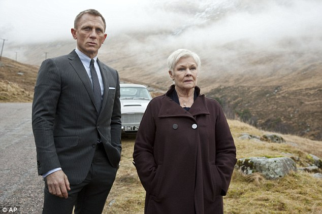A Christmas bonus: Bond cast members such as Daniel Craig, pictured left as 007, and Judi Dench pictured right as MI6 head M in Skyfall, are entitled to box-office bonuses