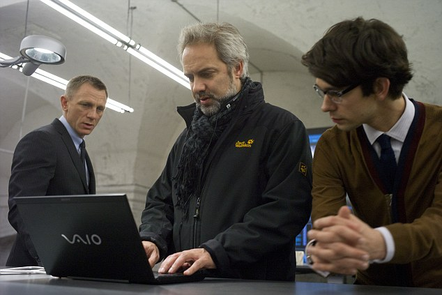 In high demand: Director Sam Mendes talks to Daniel Craig and Ben Whishaw on the set of Skyfall