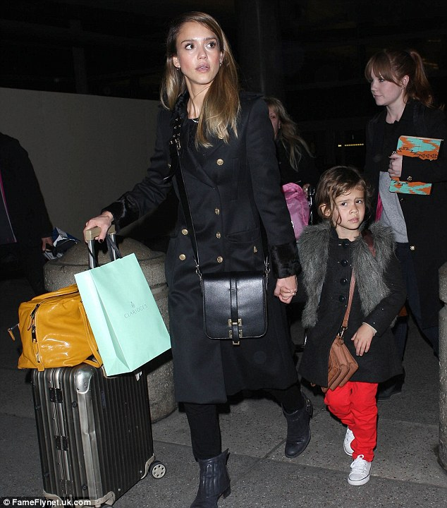 After the adventure: The family arrive back in Los Angeles after they exciting trip
