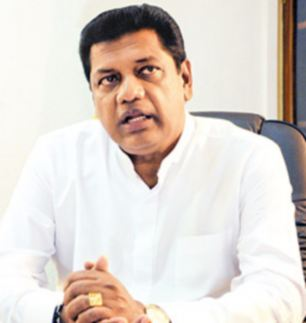 Insult: Transport Minister Kumara Welgama told Parliament he had no words to express his feelings towards MP Rosy Senanayake whom he described as ¿a charming and beautiful lady¿. She said it was an insult