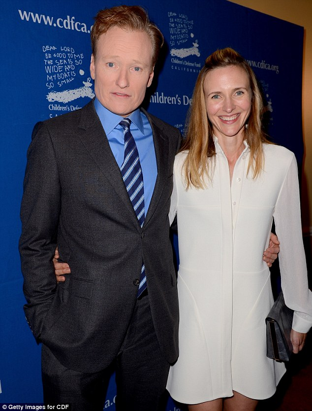 Power couple: Comedian Conan O'Brien and his wife Liza flashed smiles on their way into the event