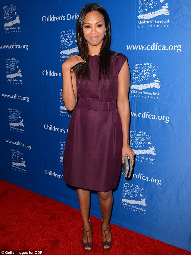 Pretty in purple: Zoe Saldana stood out in a plum Giambattista Valli dress, paired with Gucci heels