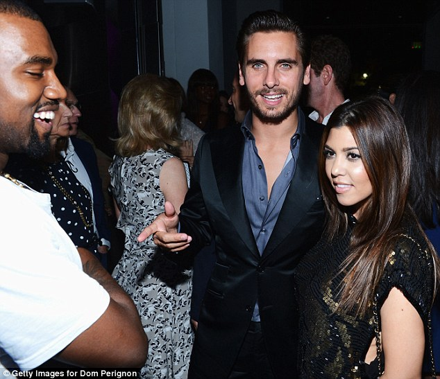 We are family: Kanye (right) with Scott Disick and Kim's sister Kourtney, who were also at the event