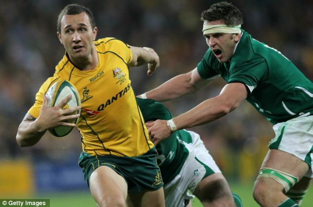 Quade Cooper of the Wallabies breaks through the Irish defence during the Lansdowne Cup Test Match between the Australian Wallabies and Ireland in 2010