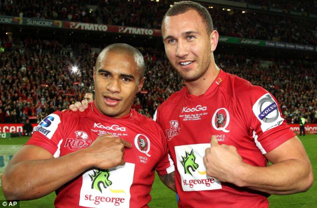 Quade Cooper celebrates with teammate Will Genia after their Super Rugby final victory over the Canterbury Crusaders in 2011