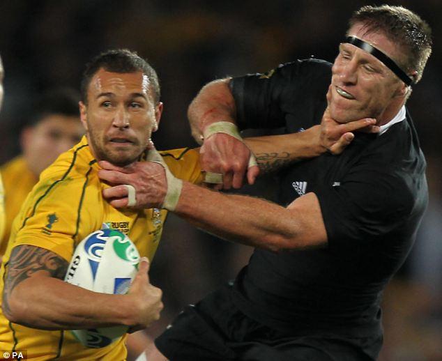 Quade Cooper battles with New Zealand's Brad Thorn in the IRB World Cup semi-final