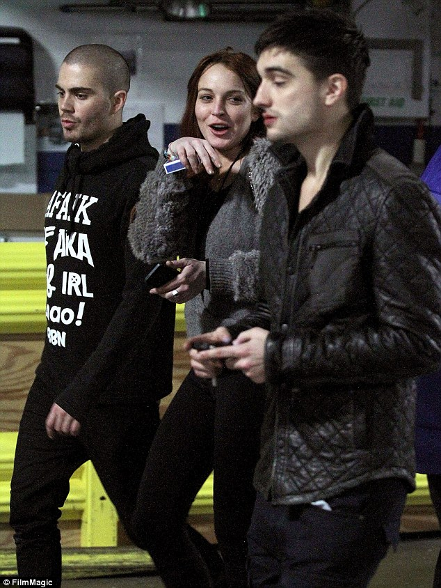 New pals: Lindsay Lohan was pictured backstage alongside Max George and Tom Parker at The Wanted's Boston Jingle Ball gig on Thursday night