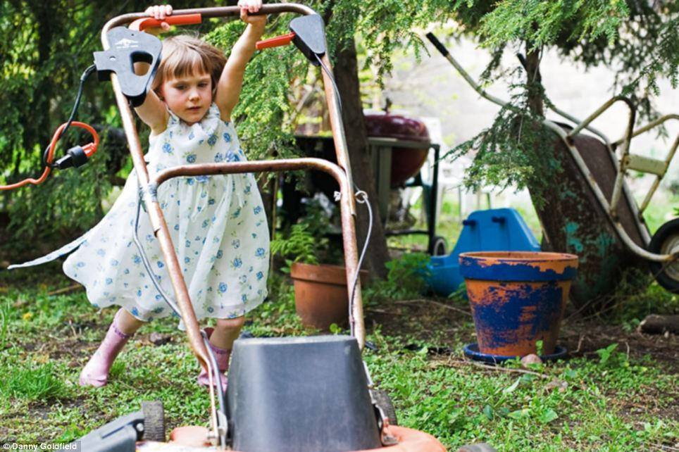 At home: Eliza, who is from the United States, helps her family with some gardening at their New York home