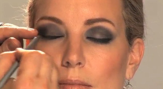 Blend: Cover the eyelid in your first shade, then apply the dark shade around the edges. Use a tissue to prevent stray powder falling on your cheeks